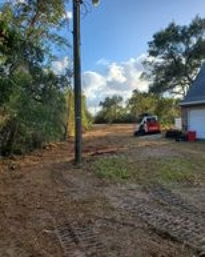 Picture of a skid steer on mulched land - Land clearing with skid steer mulcher by Devine Land Management in Mims Florida